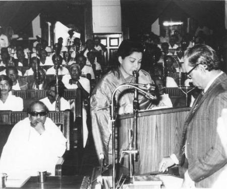 February 6, 1989- Jayalalithaa taking oath . Karunanidhi, looks on.
